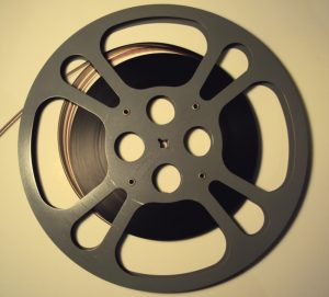 A metal reel that is about half full of film.