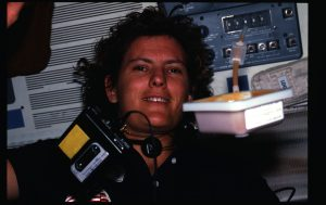 Photographic documentation showing 41G crew activities. View of Mission Specialist (MS) Kathryn D. Sullivan with cassette recorder floating in the foreground. 255-STS-41G-15-036