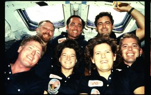 Photographic documentation showing crew portraits on the flight deck (FD). Front row (l-r) Pilot Jon McBride, Mission Specialist (MS) Sally K. Ride, MS Kathry D. Sullivan and MS David C. Leestma; back row, left to right, Payload Specialist (PS) Paul Scully-Power, Commander Robert L. Crippen and PS Marc Garneau. 255-STS-41G-19-006