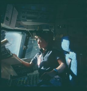 Dark views of individual STS-7 crewmembers on the aft flight deck of the shuttle Challenger during proximity operations with the Shuttle Pallet Satellite (SPAS-01). Mission specialist Sally K. Ride is photographed under the aft flight deck overhead windows.