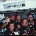 Crew members with a bag of jelly beans pose for group portrait on forward flight deck. Left to right are Commander Crippen, Mission Specialist (MS) Ride, MS Thagard, Pilot Hauck, and MS Fabian. 255-STS-s07-30-1574