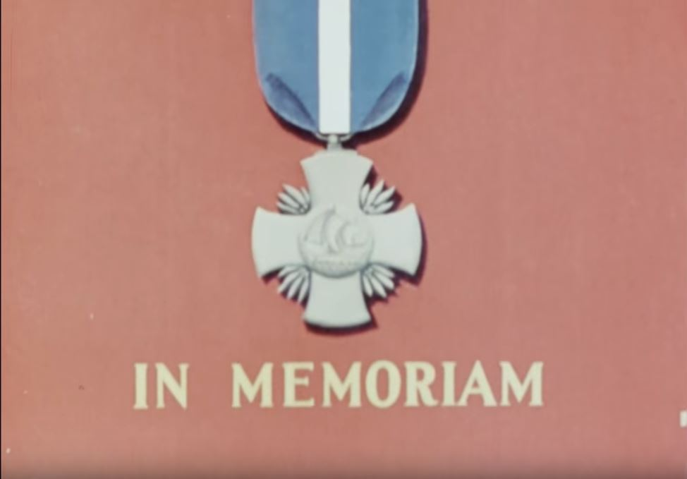 """Title card reading """"In Memoriam"""" with military medal above."""