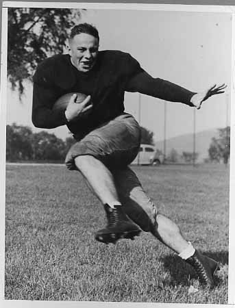 Felix (Doc) Blanchard striking a football pose during a practice session. He was drafted in 1946