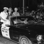 VADM William P. Lawrence, back seat, right side, and Seafair Managing Director Donald Jones, front seat, right side, take part in the Seattle Seafair '82 torchlight parade. Local Identifier: 330-CFD-DN-SN-83-01531 (https://catalog.archives.gov/id/6370019)