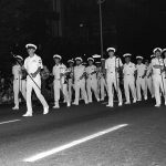 The Seattle Navy Band takes part in the Seattle Seafair '82 torchlight parade. Local Identifier: 330-CFD-DN-SN-83-01532 (https://catalog.archives.gov/id/6370020)
