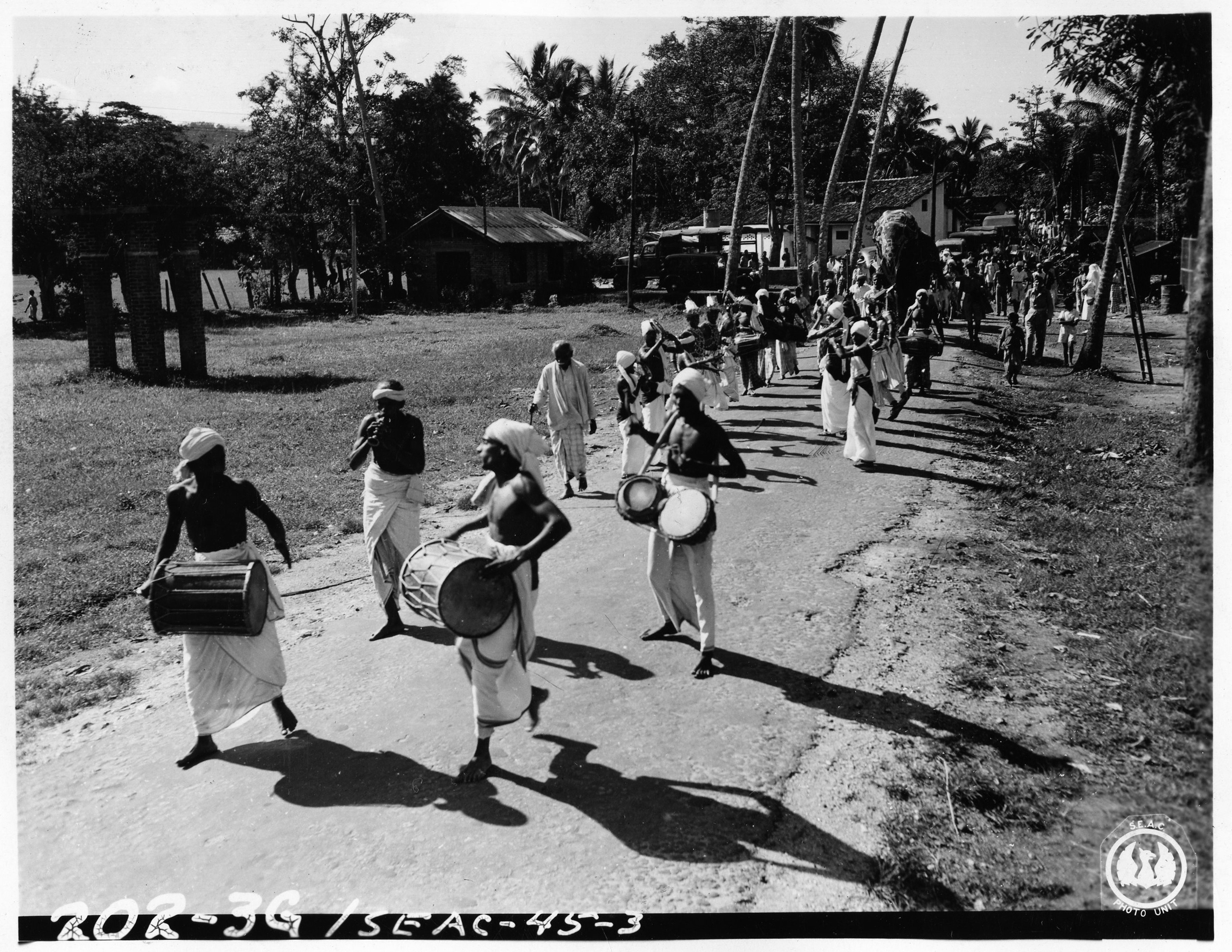 Jan 5, 1945. The procession was led by the Kandyan dancers followed by an elephant and Father Christmas in sleigh pulled by two white bullocks. The procession was enroute to a British hospital to entertain its patients during their Red Cross Christmas Party.