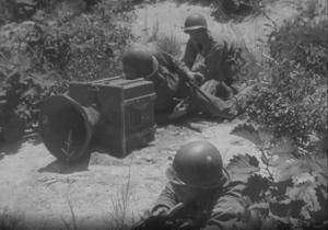 Soldiers operating a loudspeaker.