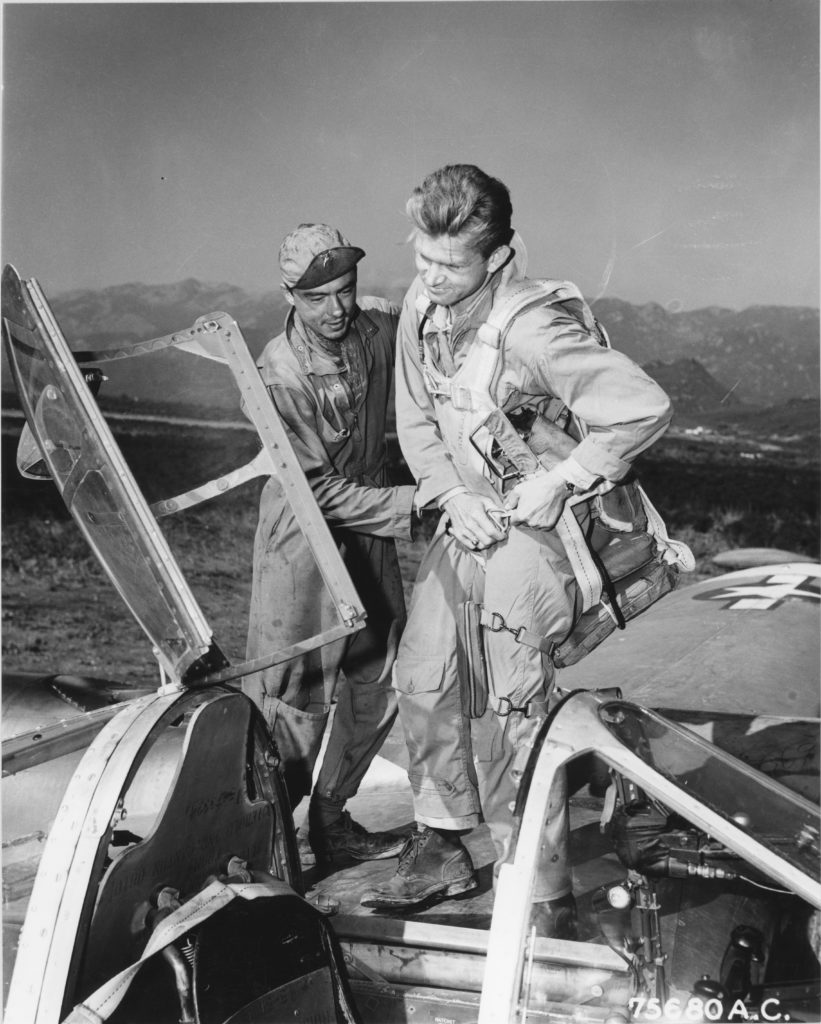 Photograph of Crew Chief Helping His Pilot