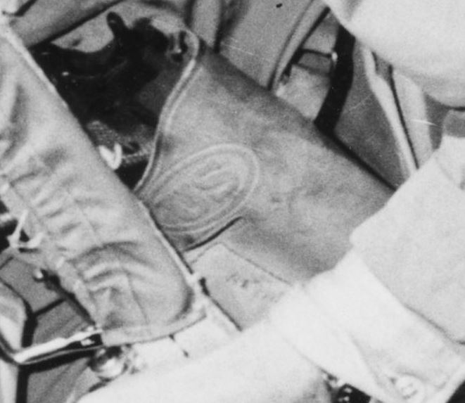 Detail of Photograph of Crew Chief Helping His Pilot
